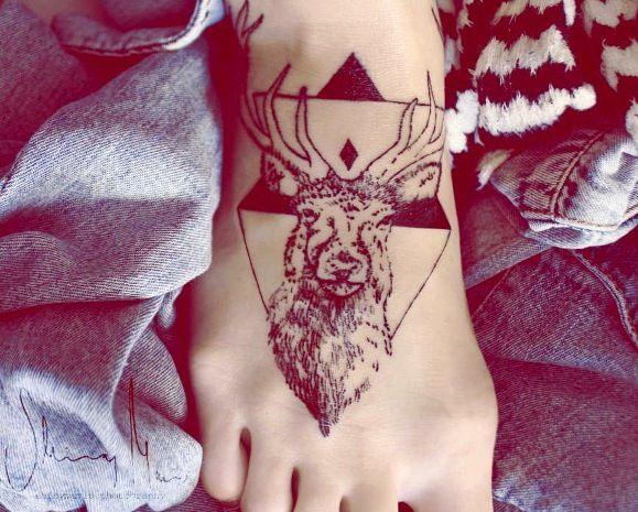 Deer tattoo with geometric background