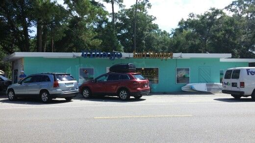 I visited Garden City beach, SC a couple weeks ago, and I discovered that the Village Surf Shoppe had been repainted. Instead of the huge murals that were there, here's what it looks like now.