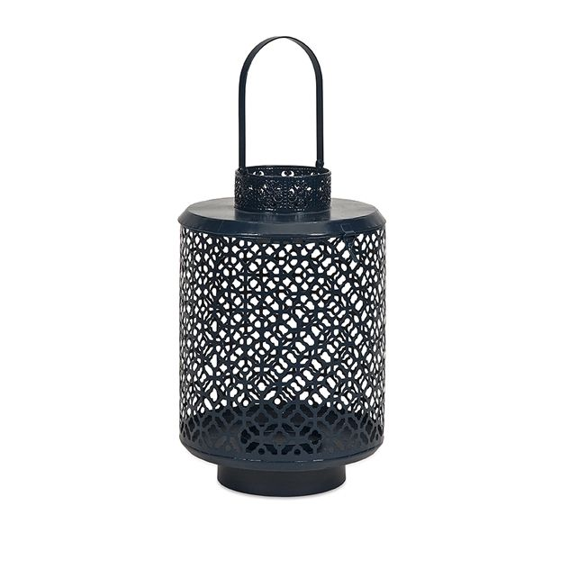 Candlelight Apartments: The Pierced Design Of The Large Navy Blue Iron Karina