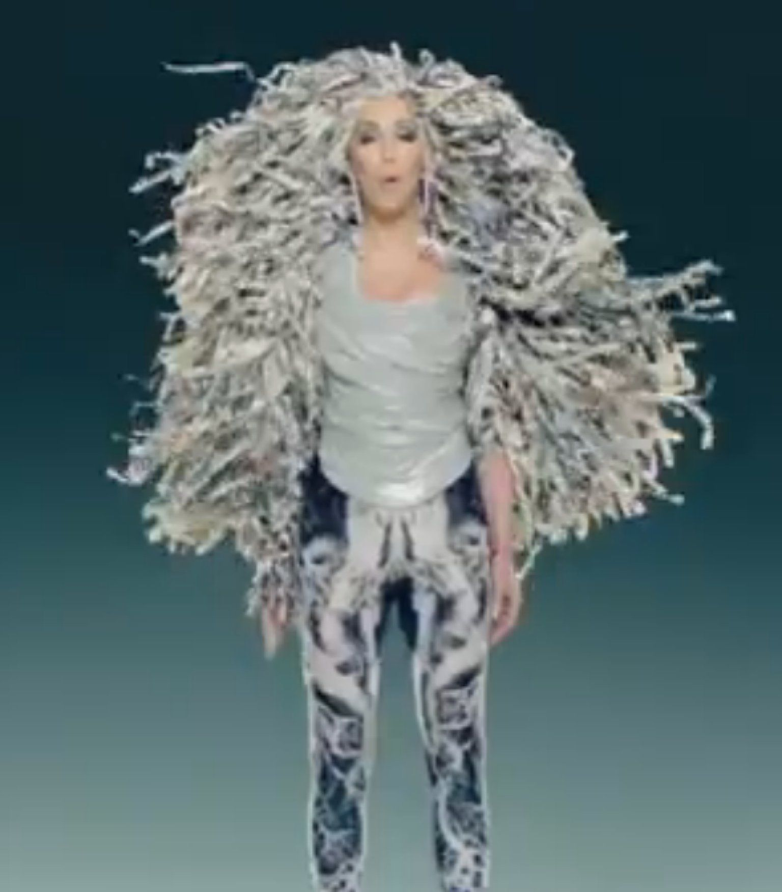 701ffeeabf Cher s  Woman s World  Video Serves Up Female-Empowerment Anthem With  Plenty Of Outrageous Hairstyles