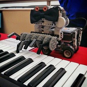 A Piano Playing Robot Wearing A Bow Tie Robotics Day At Umich Is