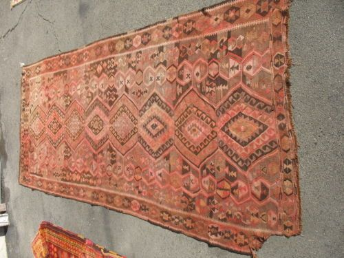 If you can find a place to hide the damaged spot, a beautiful kilim with muted colors...and cheap!