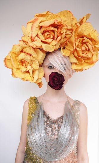 fumbalinas - A/W 15 giant statement paper flower headpiece #giantflowers #windowdisplay #orange #paperflowers #headpiece