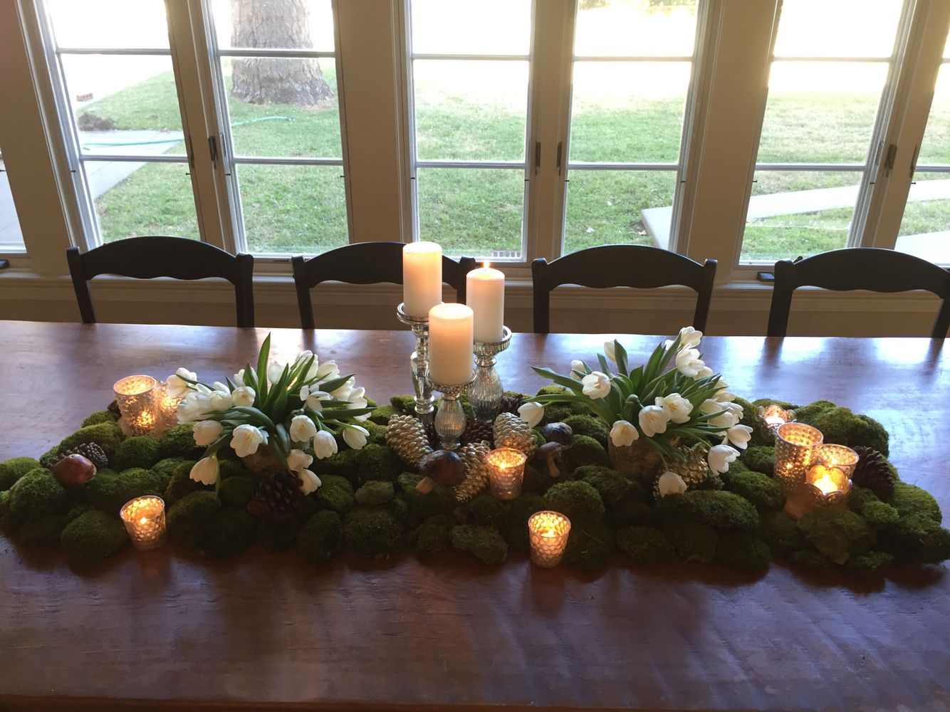 Set the mood with moss and tulips with silver Mercury glass for holiday tablescapes.