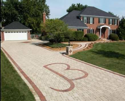 paver driveway with monogram --or could also make a scroll design ...