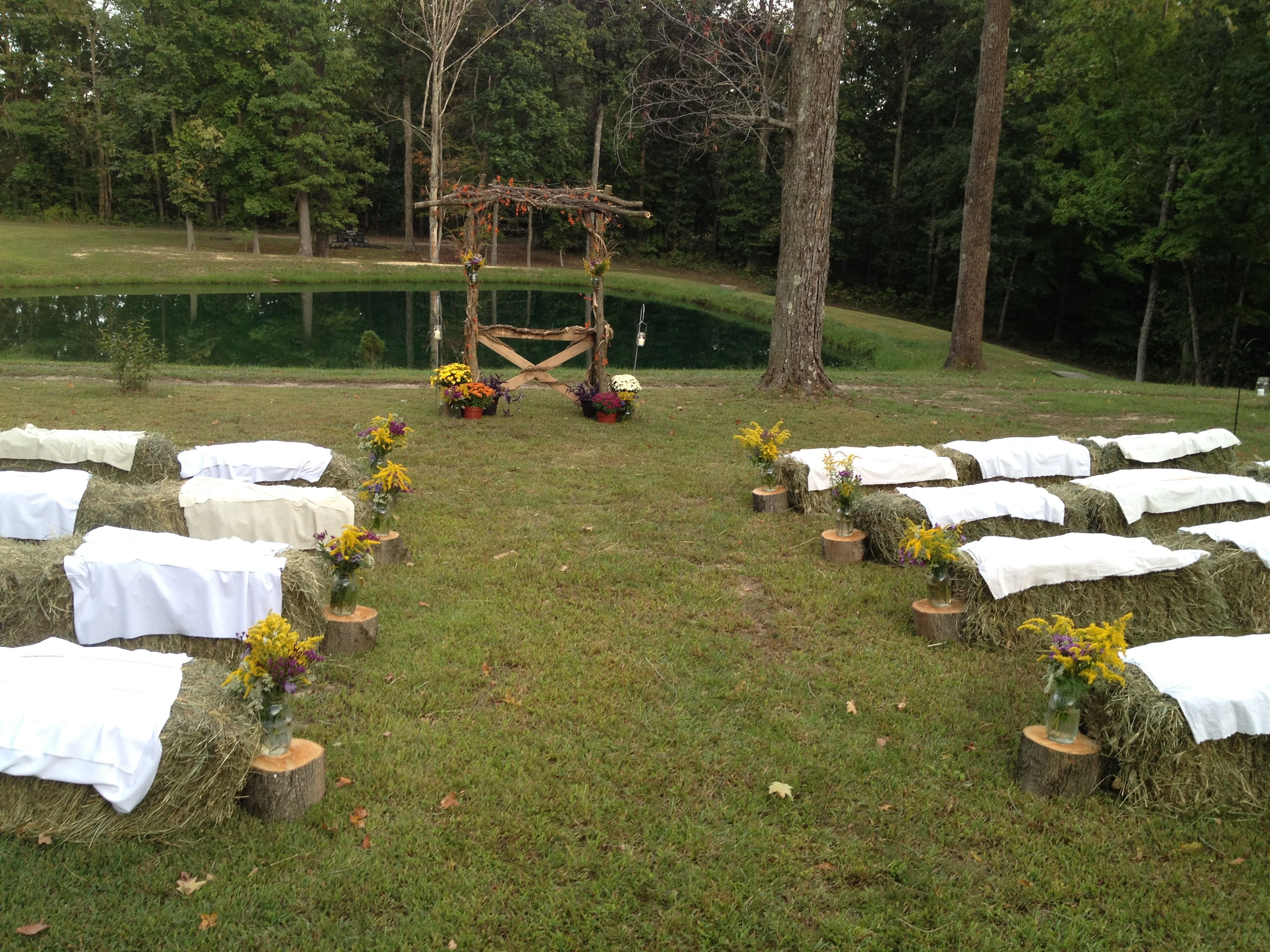 Country setting for a wedding with bales of hay for ...
