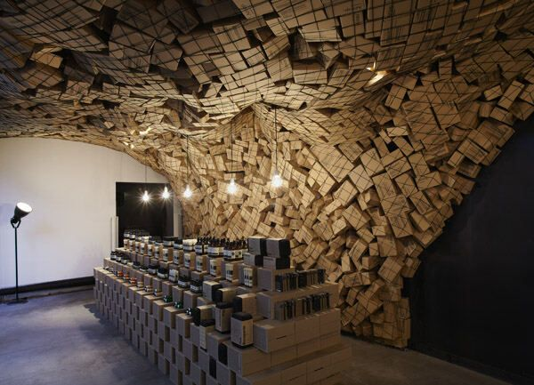 netted wall filled with handmade cardboard boxes- amazing