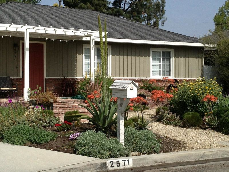 Ranch style house with beautiful drought tolerant garden for Drought resistant landscape