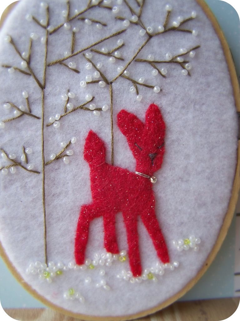 """Reindeer created with red sparkle felt.  Framed in wood oval hoop {5.25""""x4""""}"""