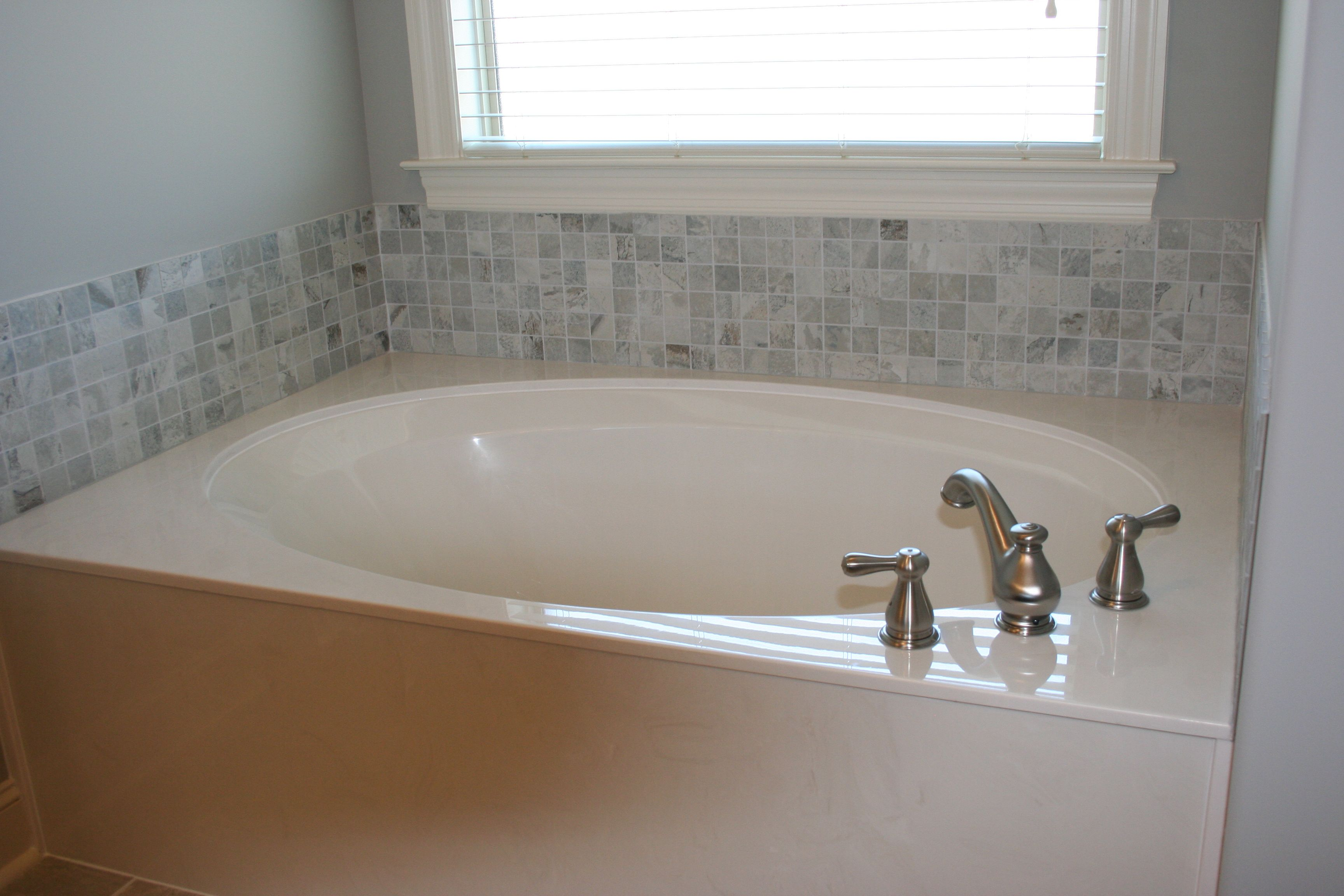 Cultured Marble Tub With Tile Backsplash
