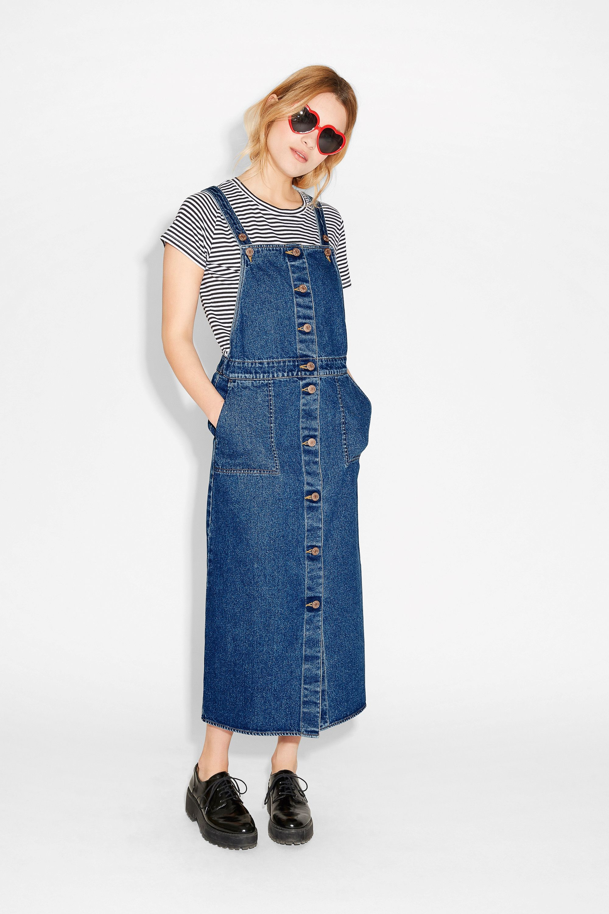 This bewitchingly cute dungaree dress is a truly multi-seasonal piece of denim. Styled with a polo? Amazing.