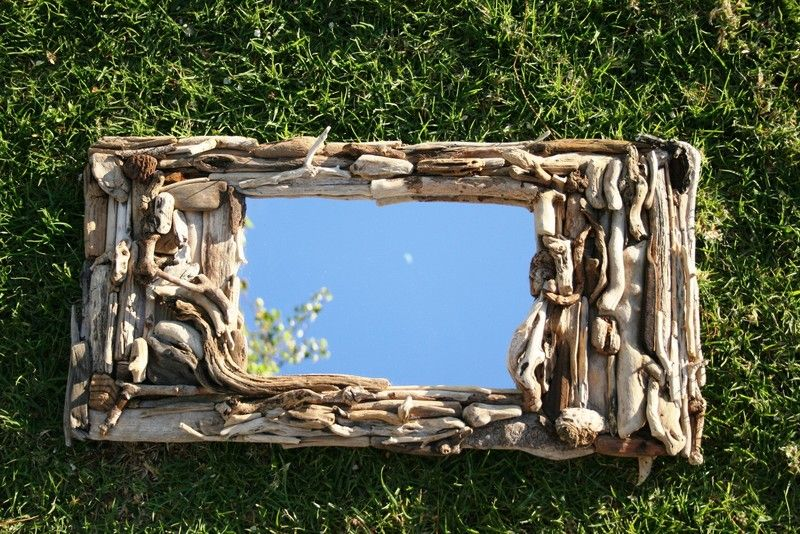 This incredible one of a kind mirror can hang beautifully vertically or horizontally. Each detailed piece of driftwood was locally found on the Southe