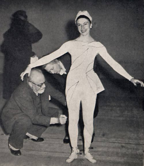 Alicia Markova and Henri Matisse as Matisse designs his costumes for the Ballet Russe de Monte Carlo production of Rouge et Noir. Choreography by Leonide Massine. Circa 1939.