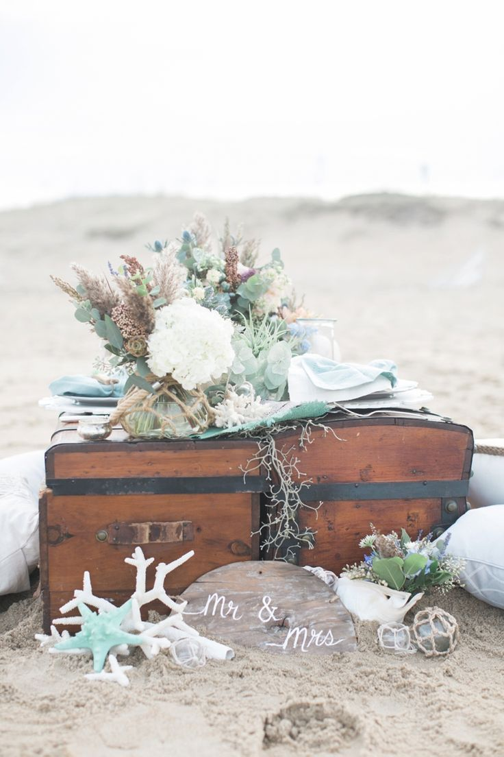 This wedding combined eclectic styles and textures with the colors of the ocean for a beautiful beach wedding.