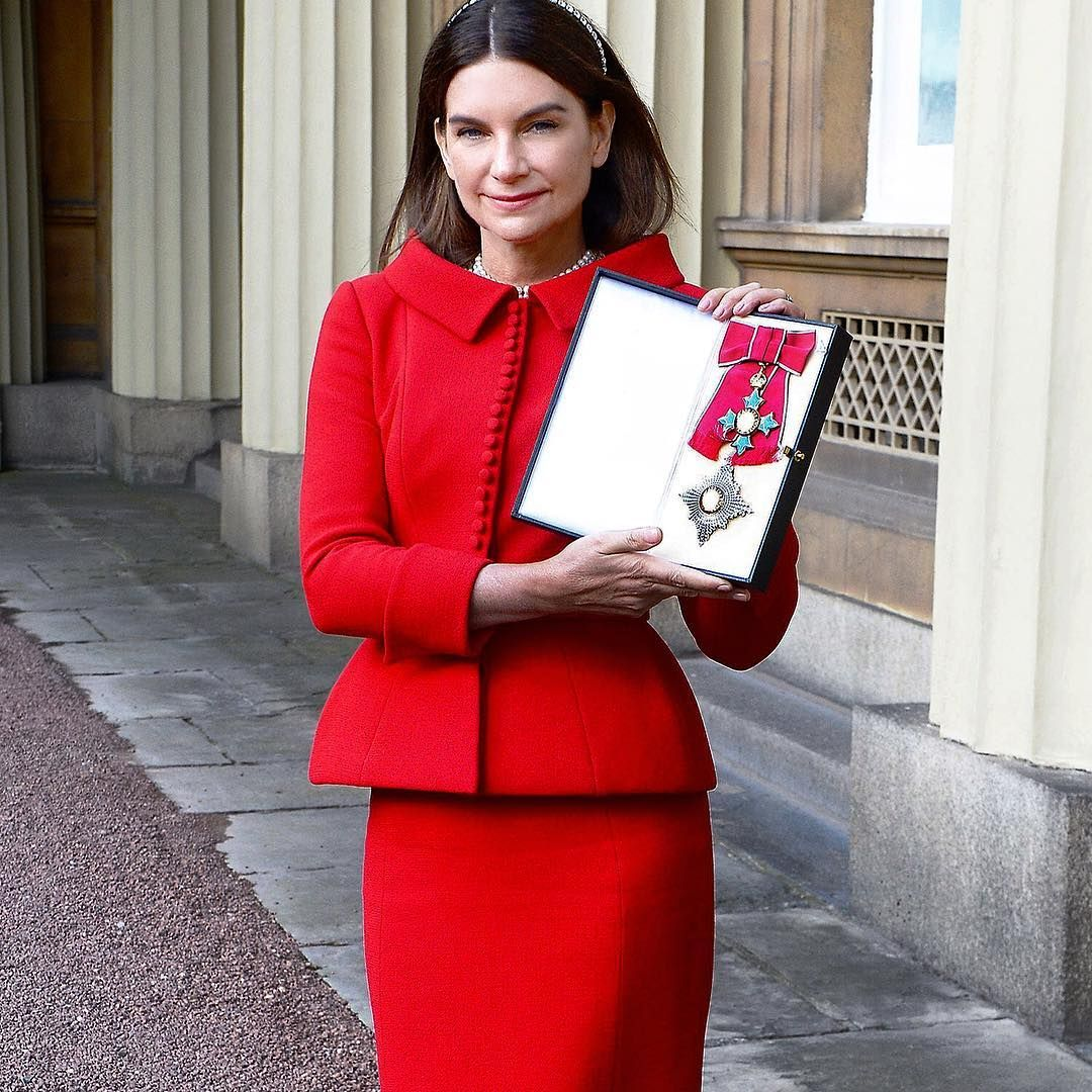 """""""Congratulations to Net-a-Porter founder Natalie Massenet who received her Damehood from The Prince of Wales today, wearing a Ralph & Russo scarlet red…"""""""