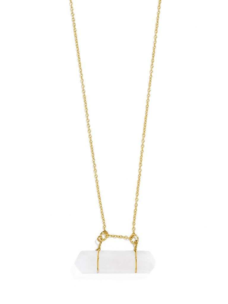 Faceted organic quartz hangs from a barelythere gold setting for a