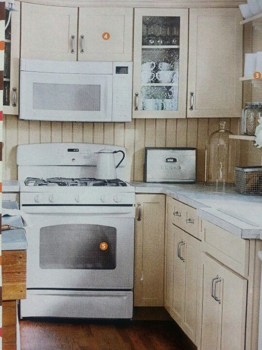 cream cabinets with white appliances--maybe i should paint my