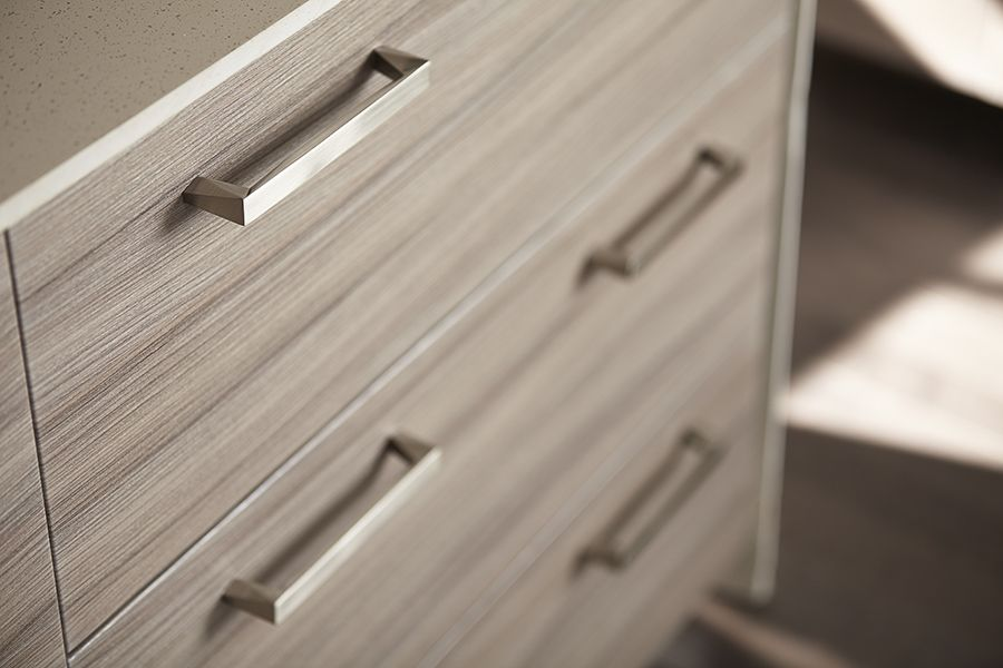 the brushed nickel swagger handles look flawless with these drawers