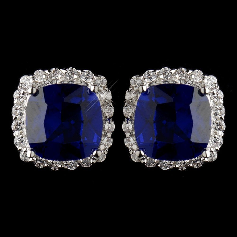 """Dazzle your ears in a Kate Middleton inspired pair of square cut, stud earring that are featured in a silver plating of clear and sapphire blue encrusted rhinestones of sparkle. These 0.5 0.375"""" (Leng"""