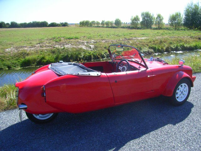 We (and Del Boy) just love the look of this classic Berkeley three-wheeler in flaming red.
