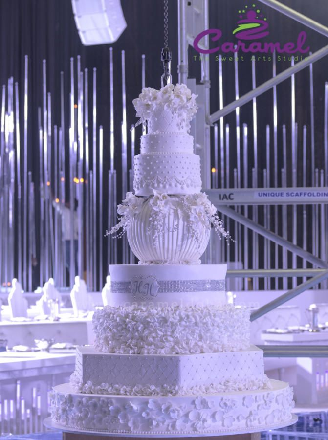 Halo Hanging Wedding Cake by Caramel Doha - http://cakesdecor.com ...