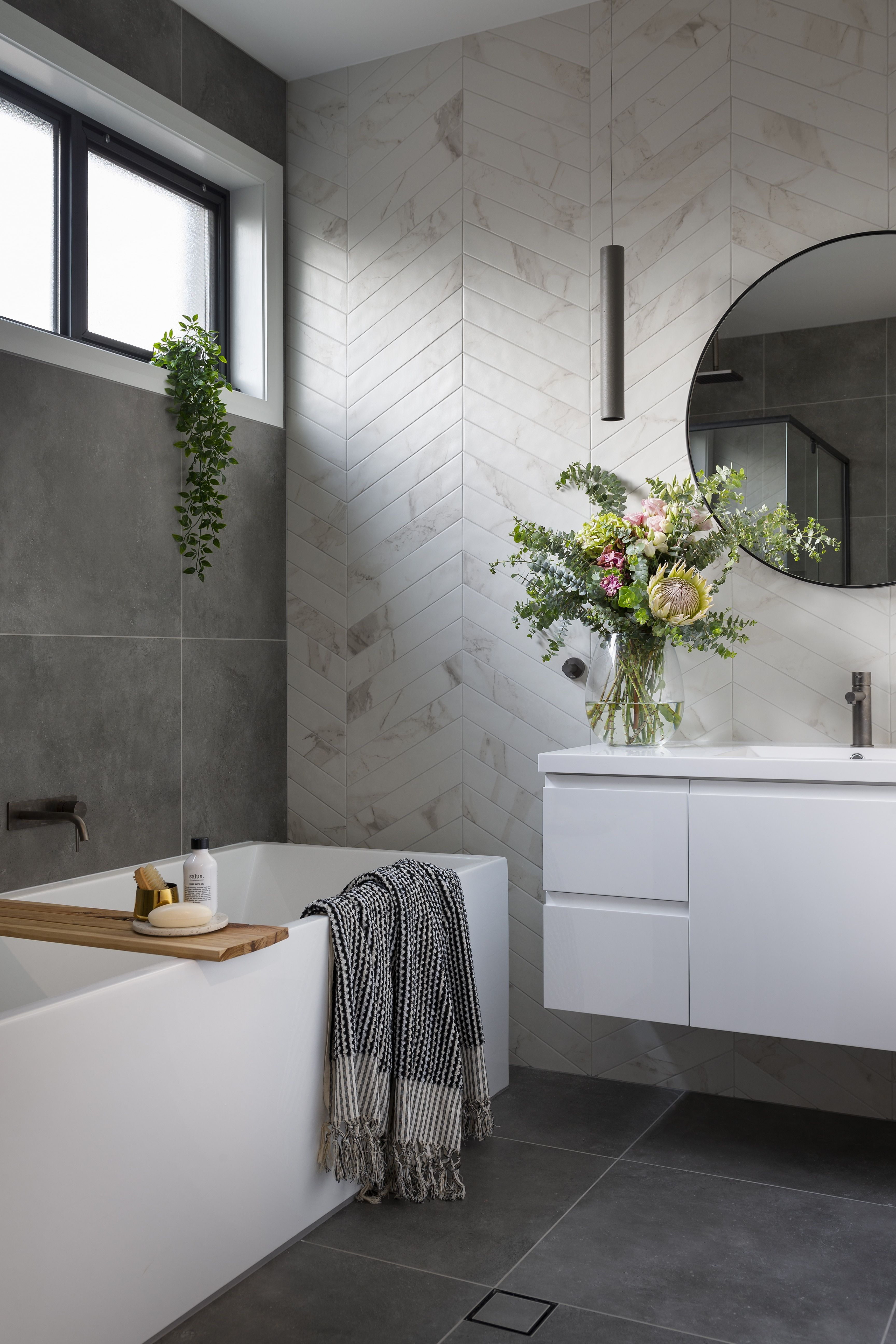 A Modern Ensuite With Marble Look Chevron Tiles And Concrete Look