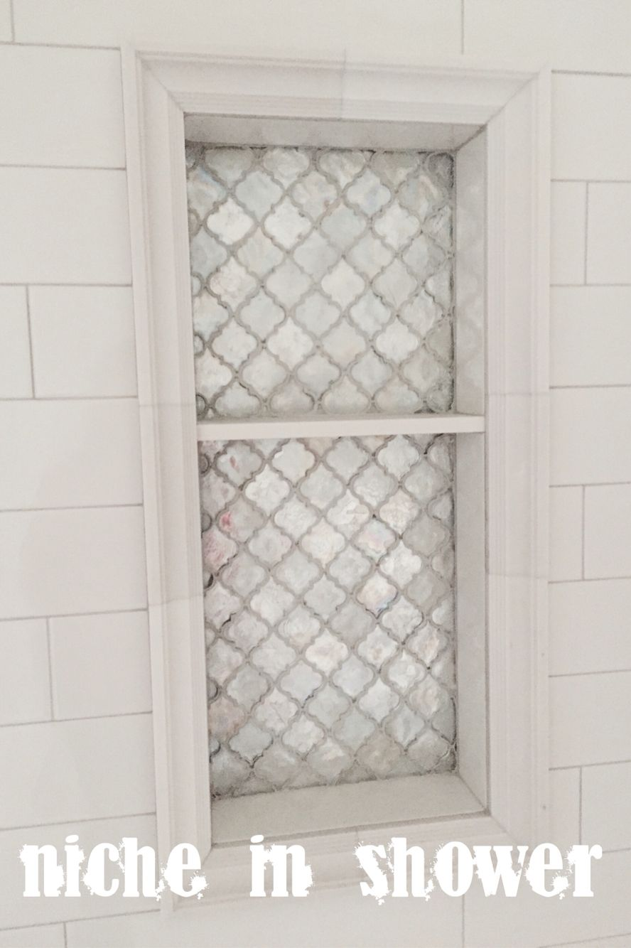 Arabesque tile, light grey grout, oversized white subway tile niche ...
