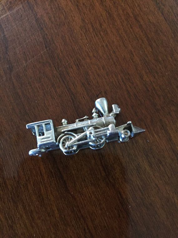 Vintage Sterling Silver Train Charm by letsgoexplorin64 on Etsy - So much detail for something less than an inch long!  Awesome!