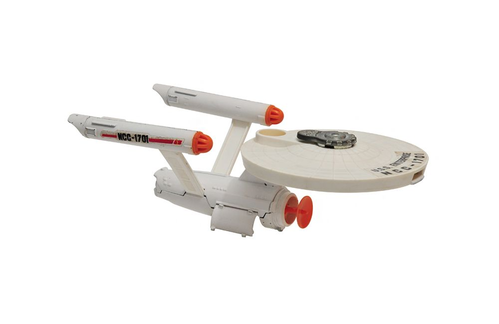 "USS Enterprise: Originally released in 1976, Dinky's incarnation of Star Trek's flagship space vehicle integrates a removable orange shuttlecraft and rapid-fire ""phaser"" defense system into a die-cast metal body. The result of this model/play mix, according to print ads at the time, was ""the most exciting die-cast toy ever!""  #startrek #dinkytoys #ussenterprise #vintagetoysUSS Enterprise"