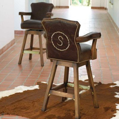 Sit in style with a personalized bar stool crafted with a sturdy hardwood maple frame padded brown leather swivel seat back and arms and nail head stud