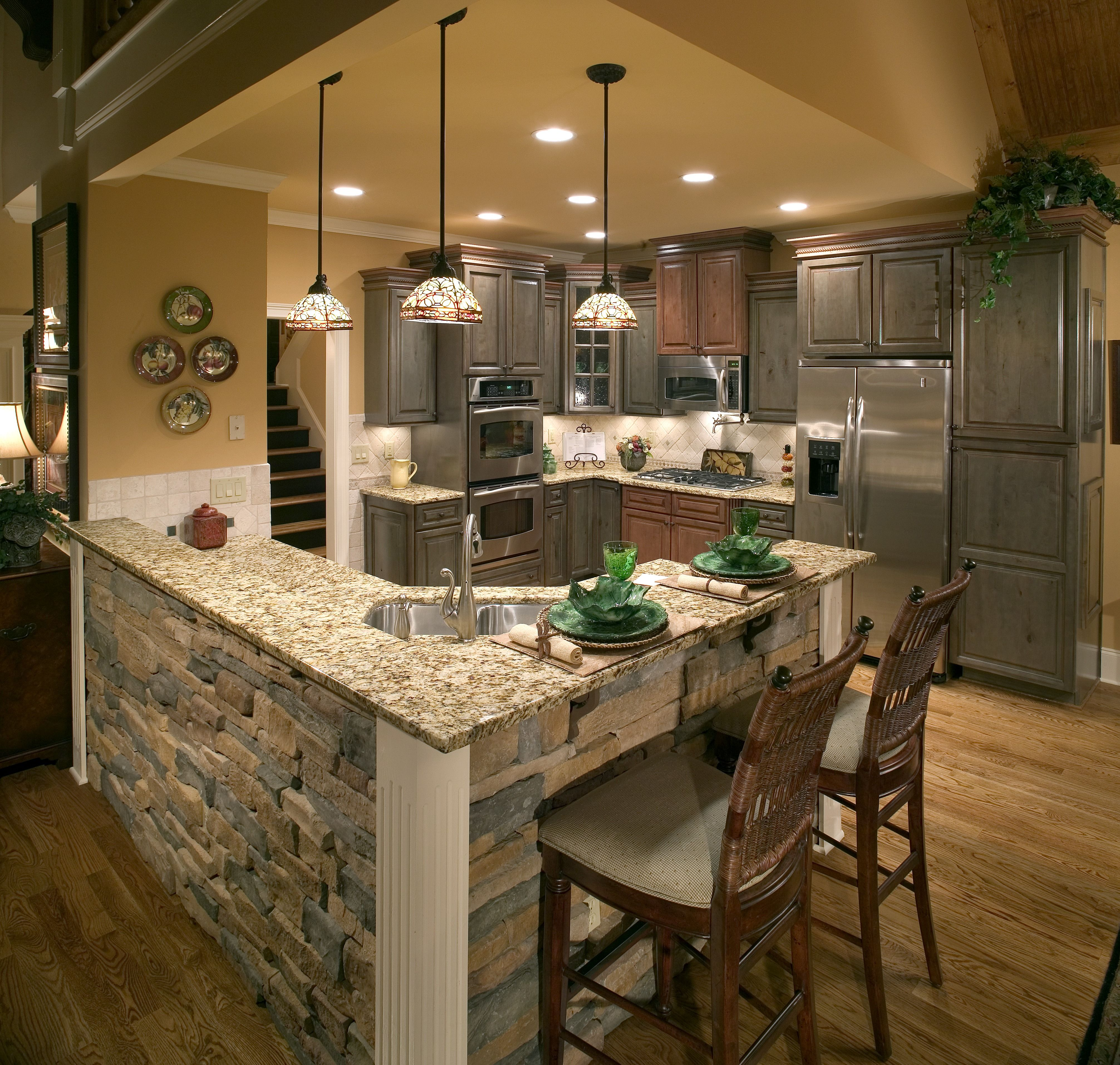 This Cozy Kitchen Features A Stone Brick Kitchen Island