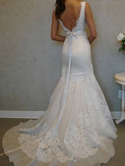 White fitted gown hugs the curves with a sweet length train this to me seems very sweet country romance love the deep lov back line adds sweet sexynees and yes sweet innocence with the ribbon sash and lace train