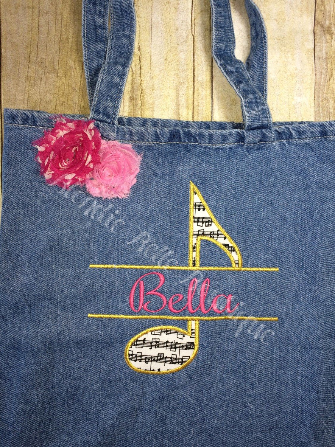 A personal favorite from my Etsy shop https://www.etsy.com/listing/469813723/personalized-split-music-note-bag