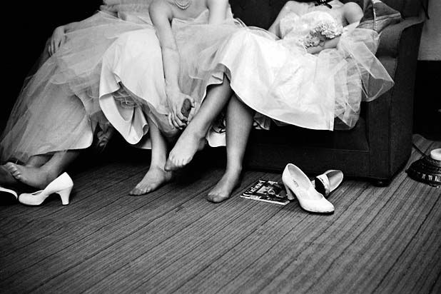 Teenage Girls Resting Feet at First Formal Dance at the Naval Armory,    Cornell Capa . (1918 - 2008)