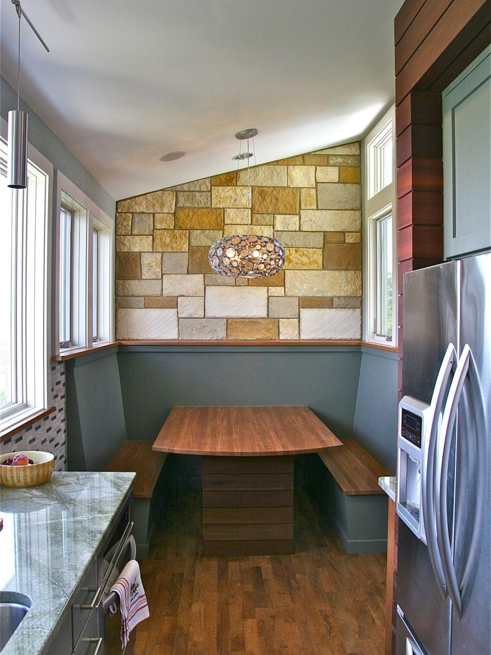 An intimate breakfast booth off the main kitchen work area provides ...