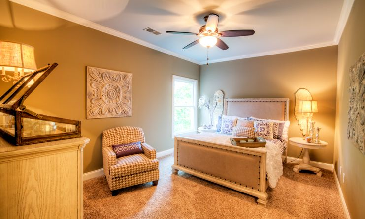 Neutral colors, beautiful accents and a Hunter ceiling fan help make