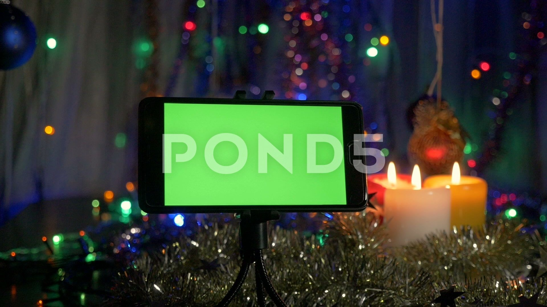 smartphone with a green screen on a new years background movement of the stock