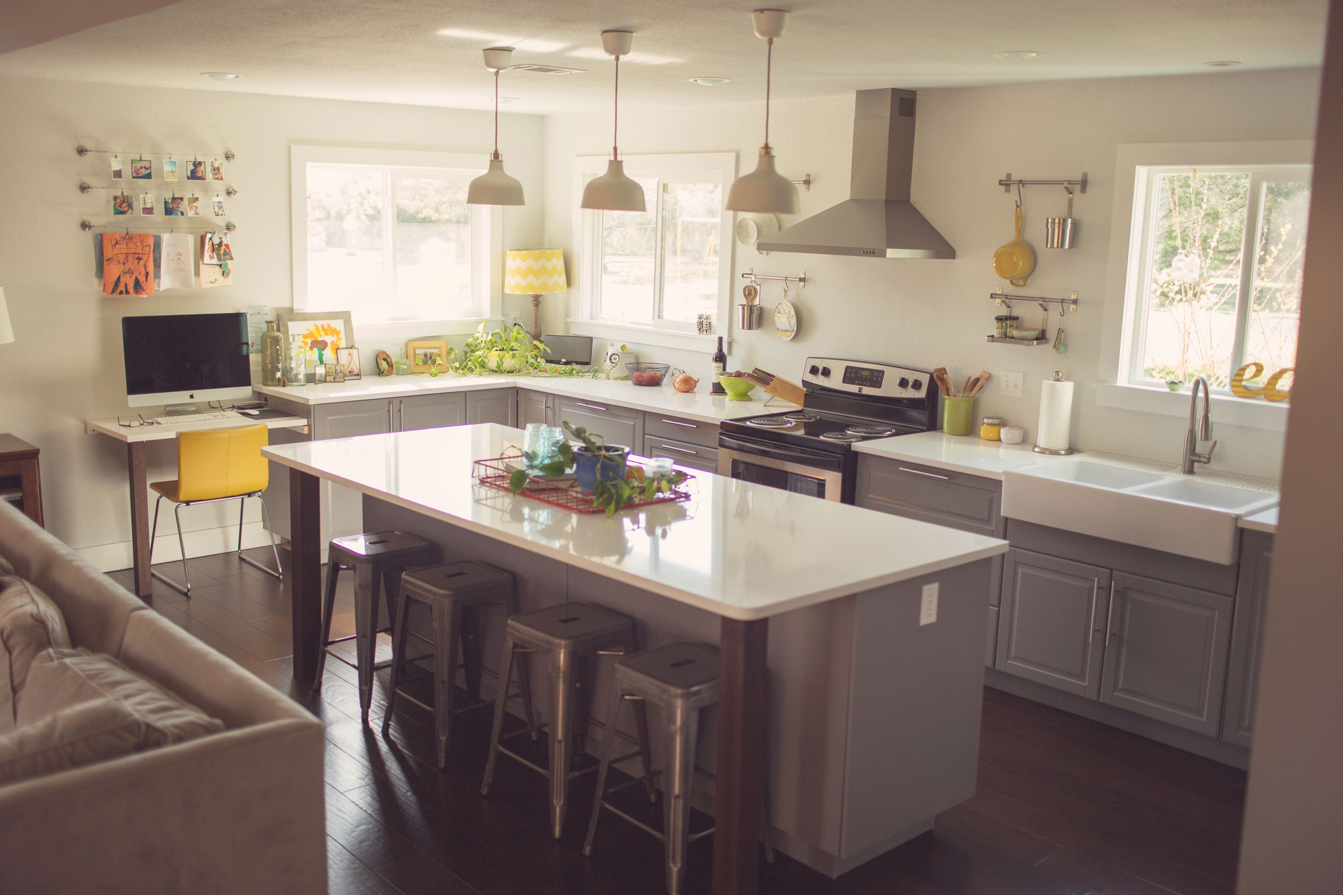 Modern kitchen with snow white quartz counter long peninsula and white - White Zeus Extreme Silestone Quartz Countertop In A Modern Farmhouse Styled Kitchen With Yellow Accents And