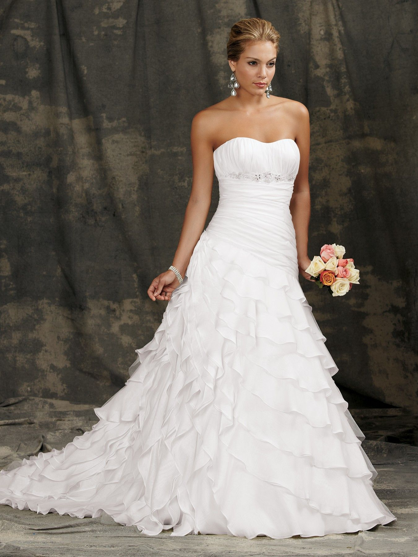 b0b99a5bf5 Cascading flounces sweep the floor of this Luxe Organza ball gown with a chapel  train. Ruched