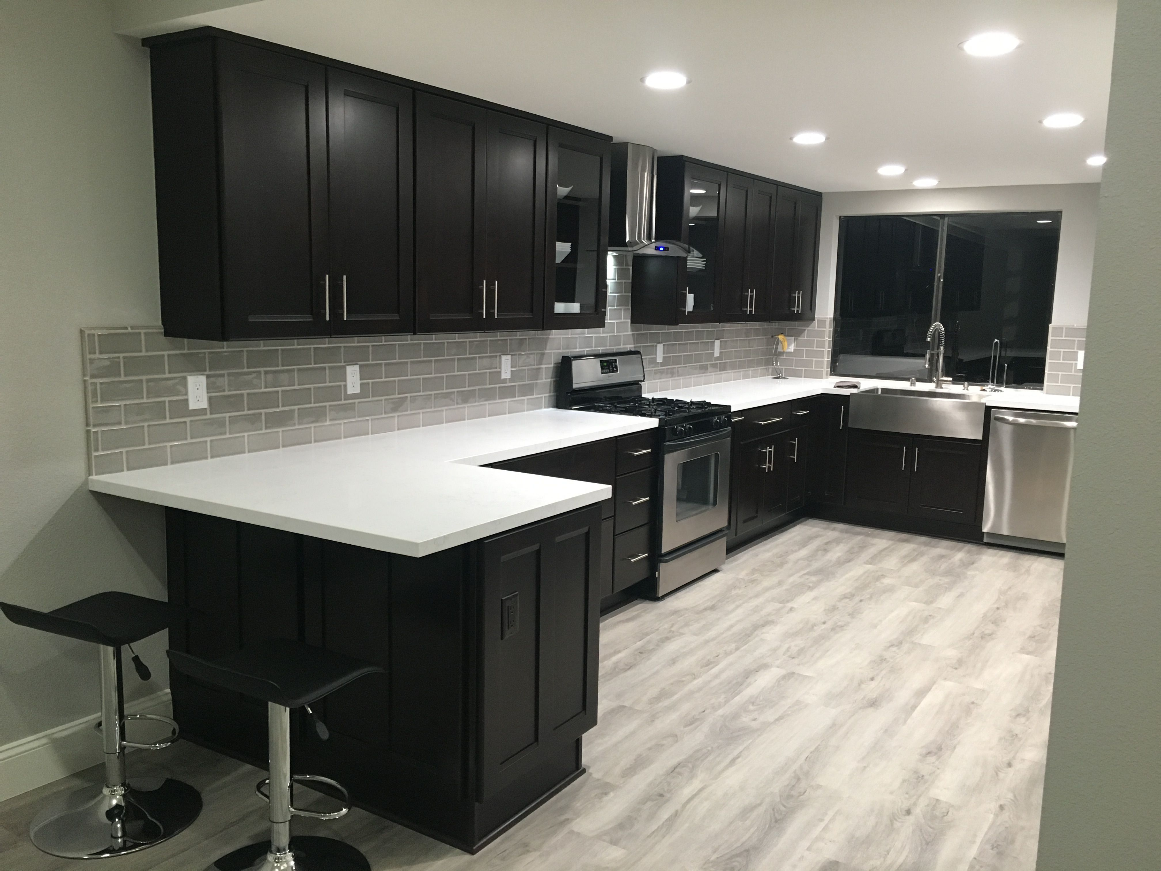 Kitchen remodel with espresso cabinets and waterproof ...