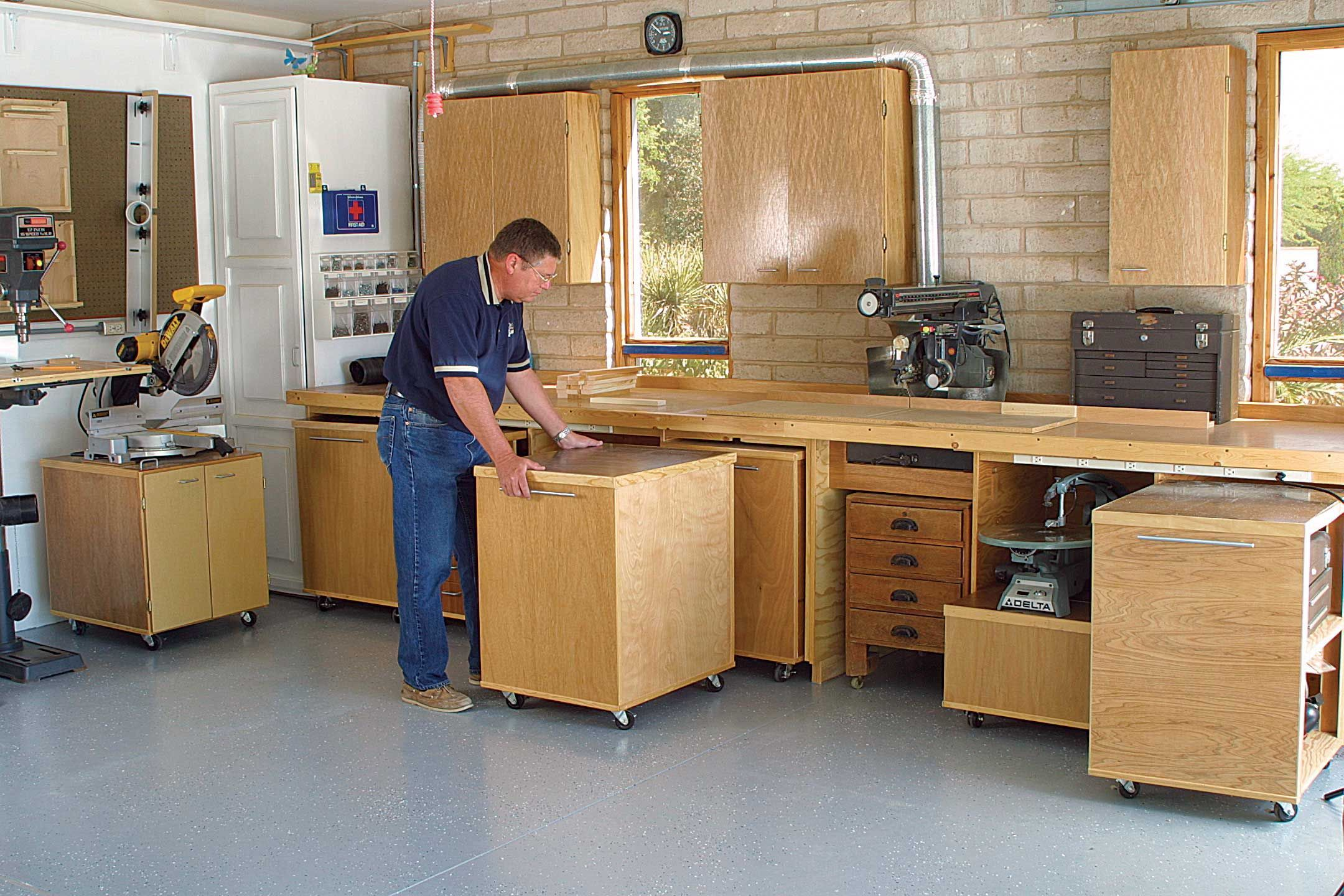 Photo of AWESOME Workshop or Garage setup! Rollout storage units – extra workspace on top…