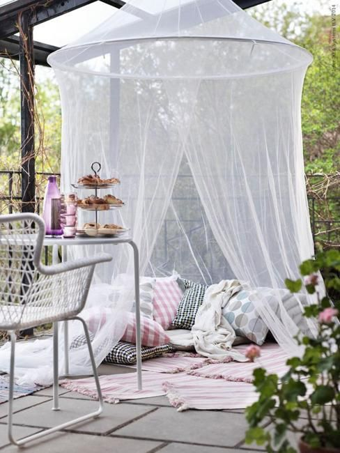 summer decorating with mosquito netting to create protected from bugs shelters NOTE Use idea on base of pergola for the girls