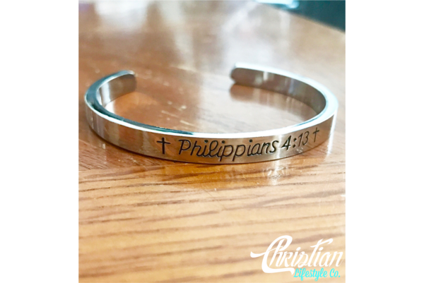 """Philippians 4:13 -""""I can do all things through Christ who strengthens me."""" Product Details: Material: Zinc Alloy Plating: Silver Rhodium Plating Sizing: One"""