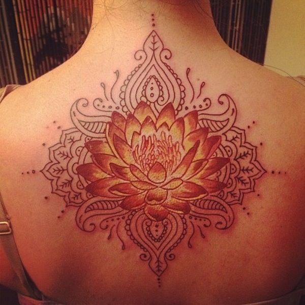 lotus flower tattoos   35. lotus flower tattoo with tribal touch