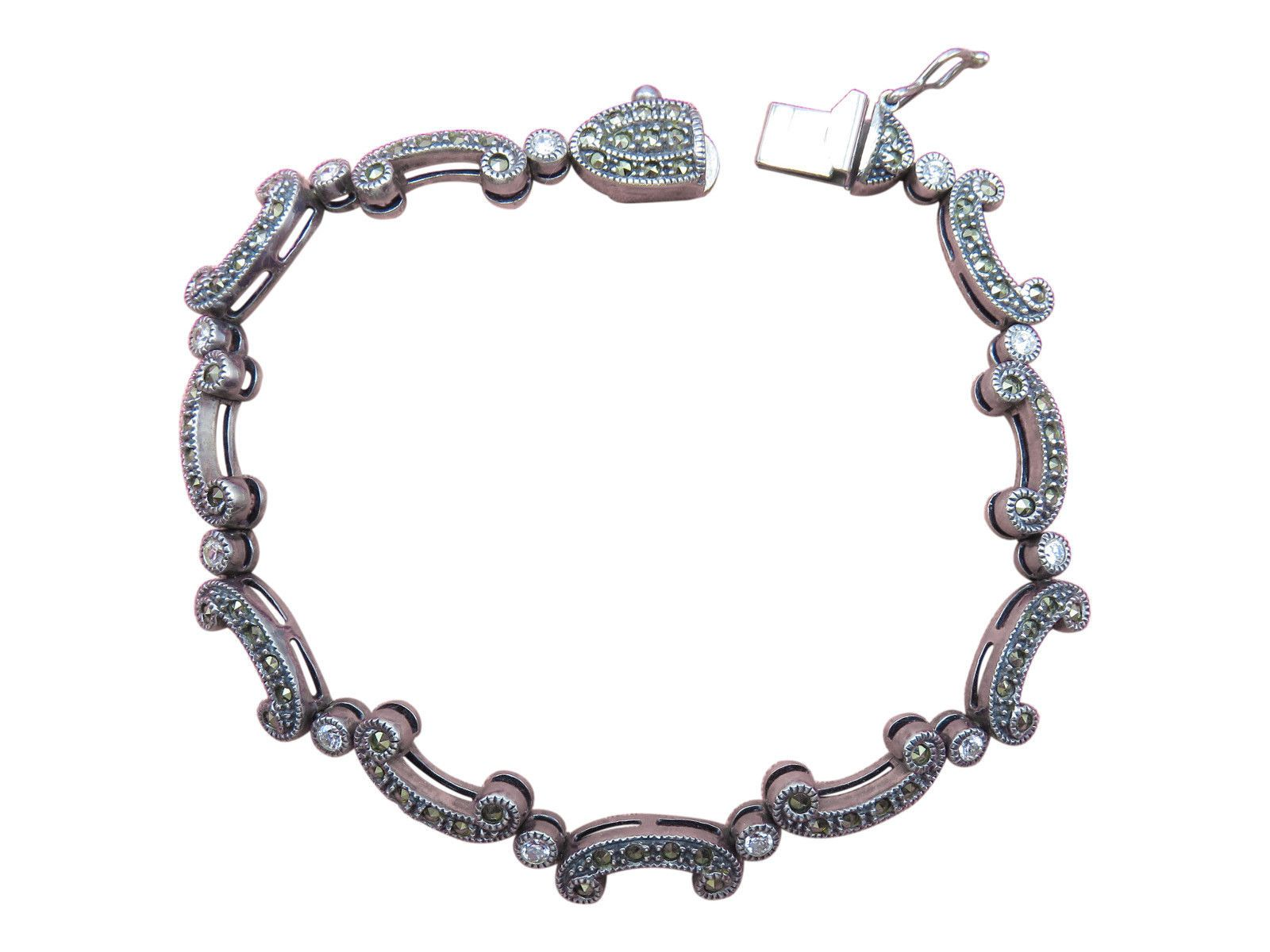 Beautiful wrist candy, this Judith Jack sterling silver bracelet hosts marcasite detail with gorgeous rhinestone accents.