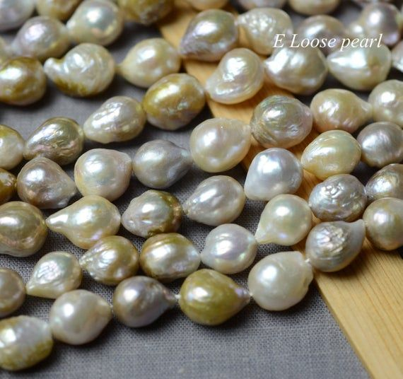 Material : Freshwater pearlsGrade : AALuster : HighBody : CleanShape : Nucleated pearlSize : 11-13mm x 14-16mmQuantity / Length : 27pcs - Full strand / 40cm=15.7 inchesColor : Nature color Weight : 80gCondition : New and goodItem No : PL4463More Edison, Flameball pearls website connection.www.etsy.com/shop/LoosePearl/items?ref=hdr_shop_menu&section_id=10166839More Stud earrings pearls website connection.www.etsy.com/shop/LoosePearl?ref=hdr_shop_menu&section_id=21231222More Leather pearls necklac