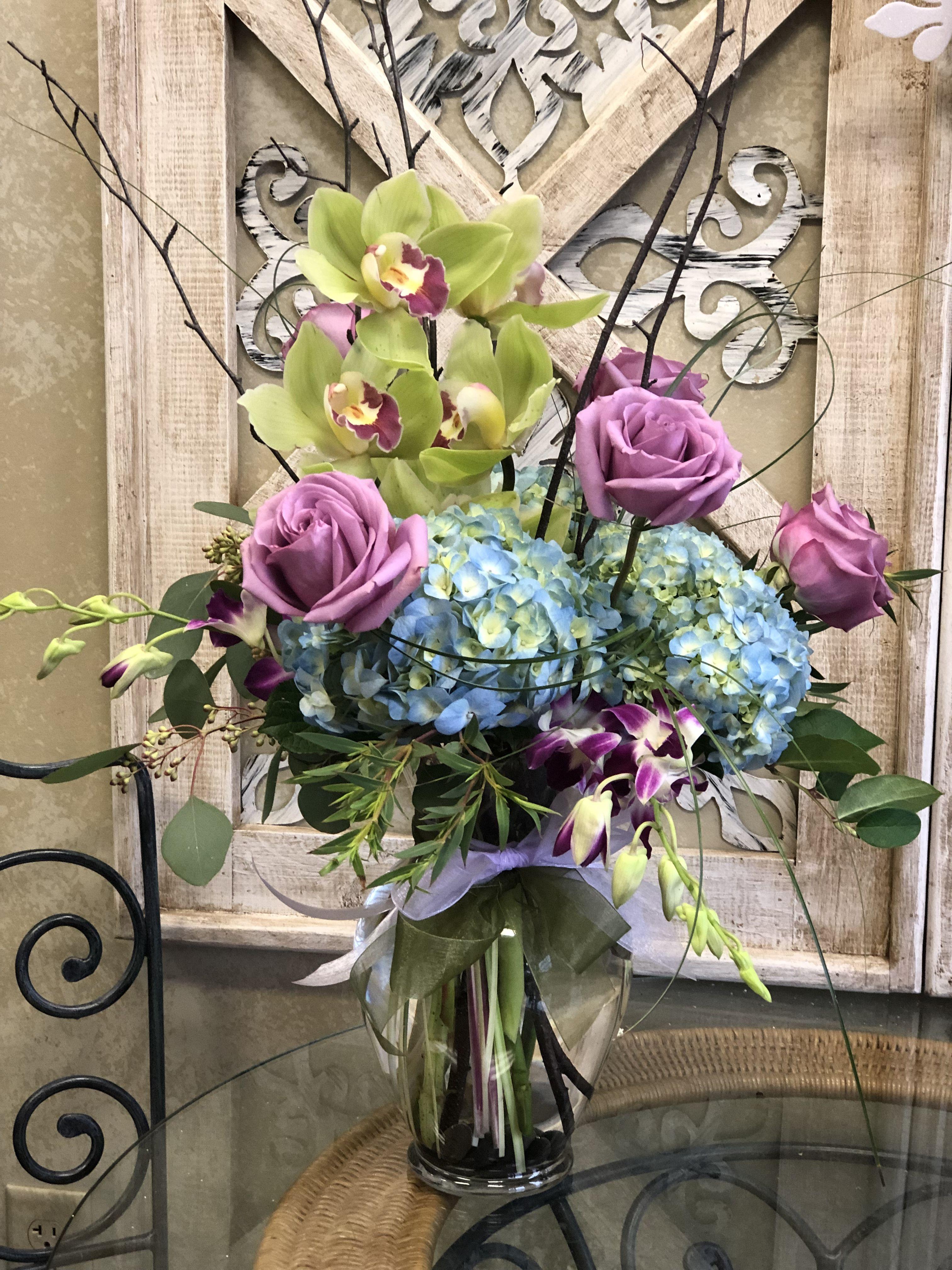 Green orchids blue hydrangeas lavender roses fresh