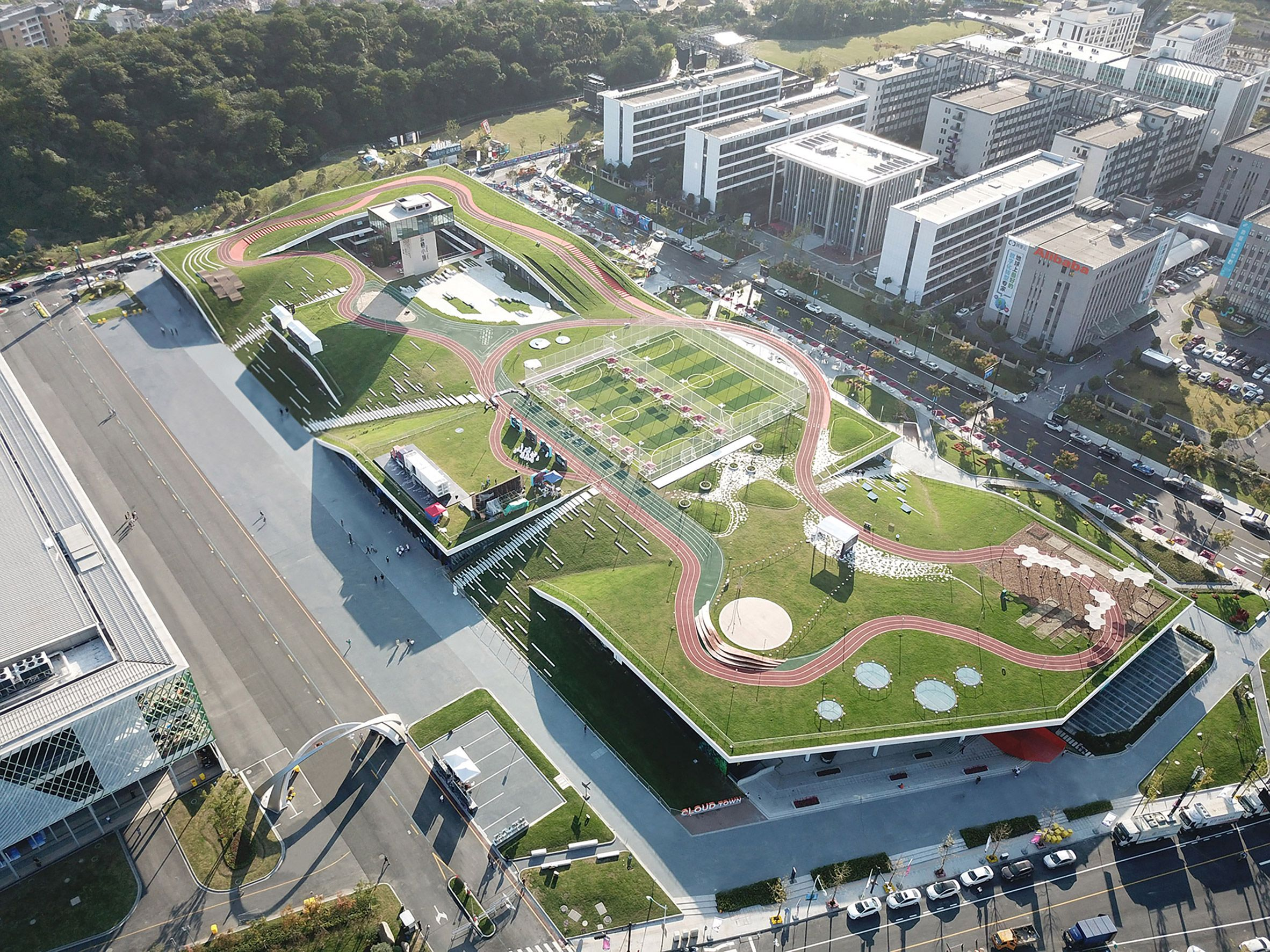 Hangzhou Cloud Town Exhibition Center By Approach Design Has A Green Roof With A Running Track City Parks Design Parking Design Park Landscape