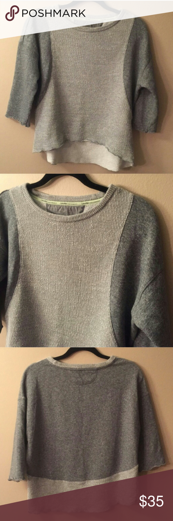 CALVIN KLEIN PERFORMANCE oversized EUC!! Oversized and super comfortable three-quarter sleeves and high low hem two-tone gray quick-dry knit material made flat chest measures 20inches  and a half in length from shoulder to hem is 24 inches and 20 inches in front Calvin Klein Sweaters Crew & Scoop Necks