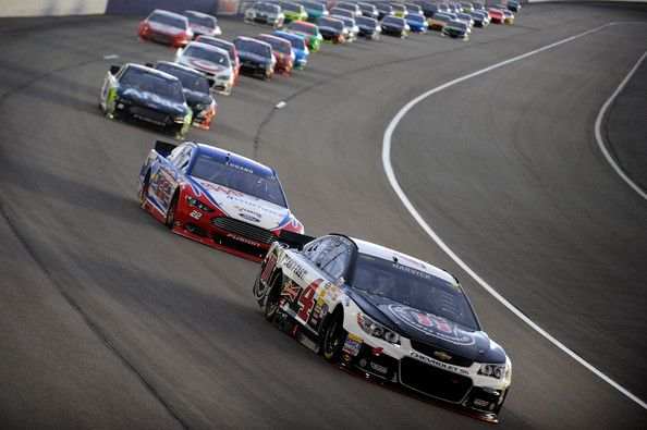 Kevin Harvick, driver of the #4 Jimmy John's Chevrolet, leads a pack of cars during the NASCAR Sprint Cup Series 5-Hour Energy 400 at Kansas Speedway on May 10, 2014 in Kansas City, Kansas. http://www.pinterest.com/jr88rules/nascar-2014/ #NASCAR2014